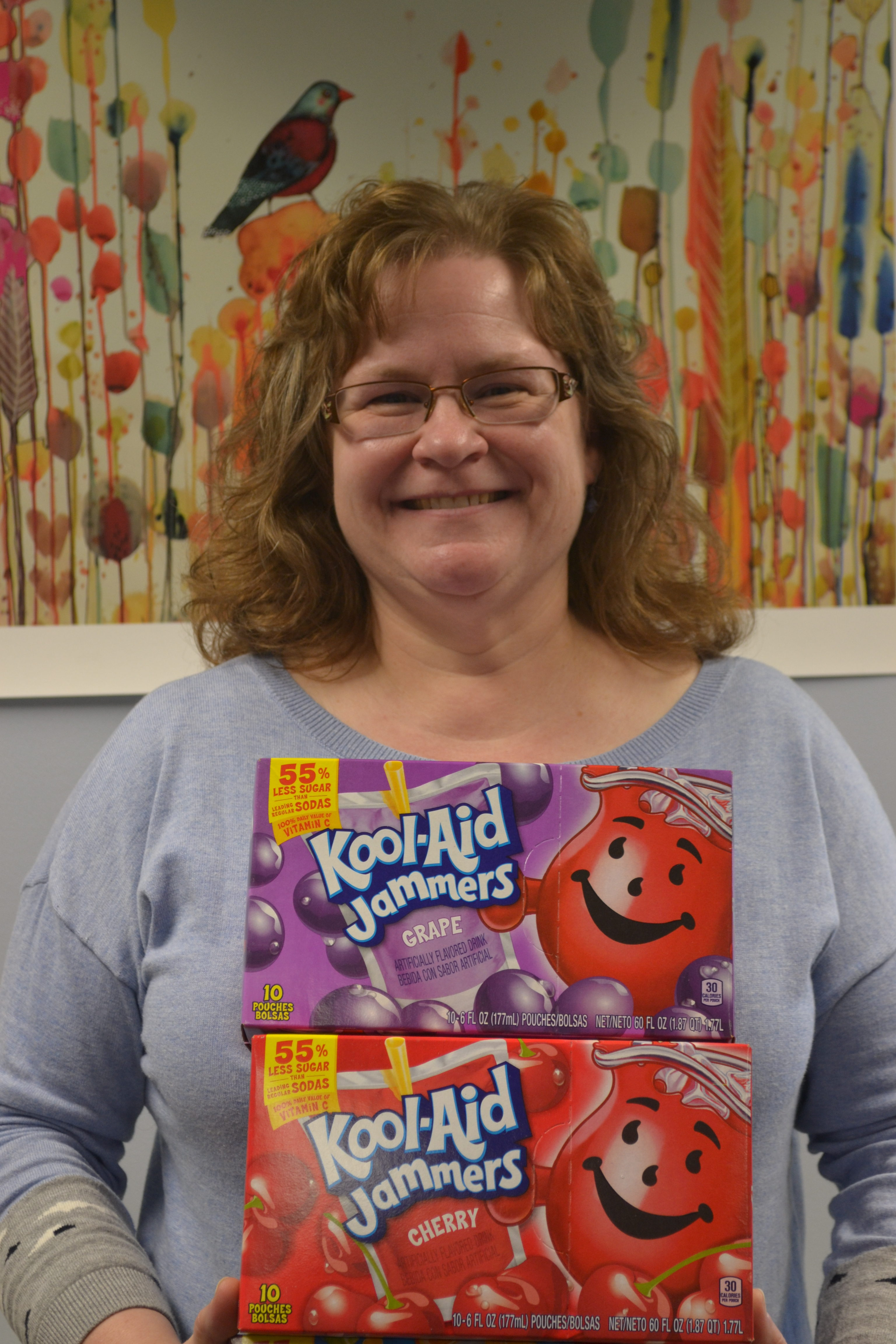 Kathleen Hunzer poses with several boxes of Kool-Aid.