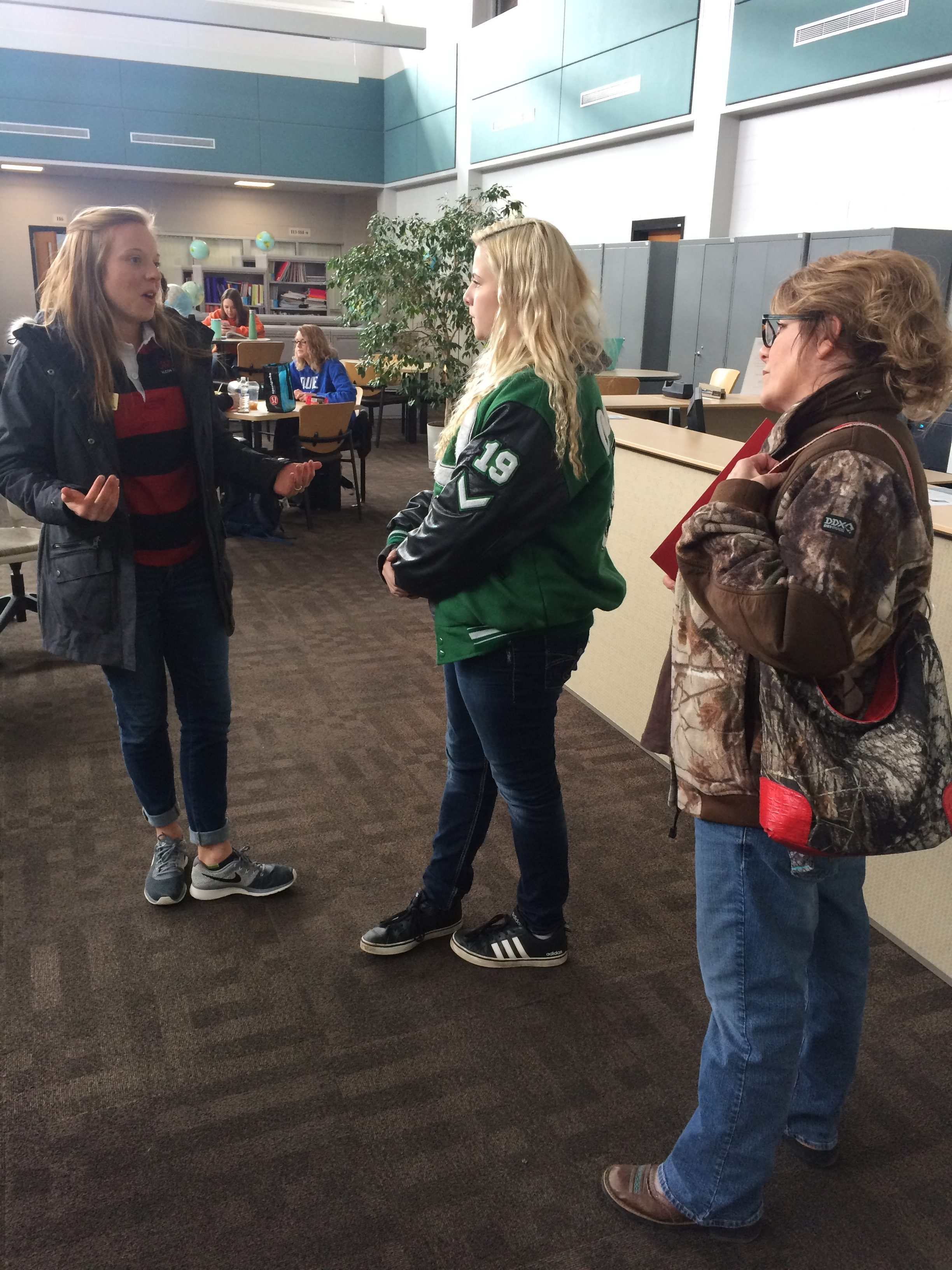 Bryanne Stites (left) is a Falcon guide at UWRF. She gave a tour to Ashley Ertel and her mom Becky Swagger on March 21.