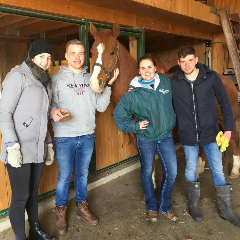 José Verbeek, Kas Elferink (left), American student Theresa Lusk and William Van Mourik visiting Lusk's horse over Easter weekend in La Crescent, Minn. Photo provided by Theresa Lusk.