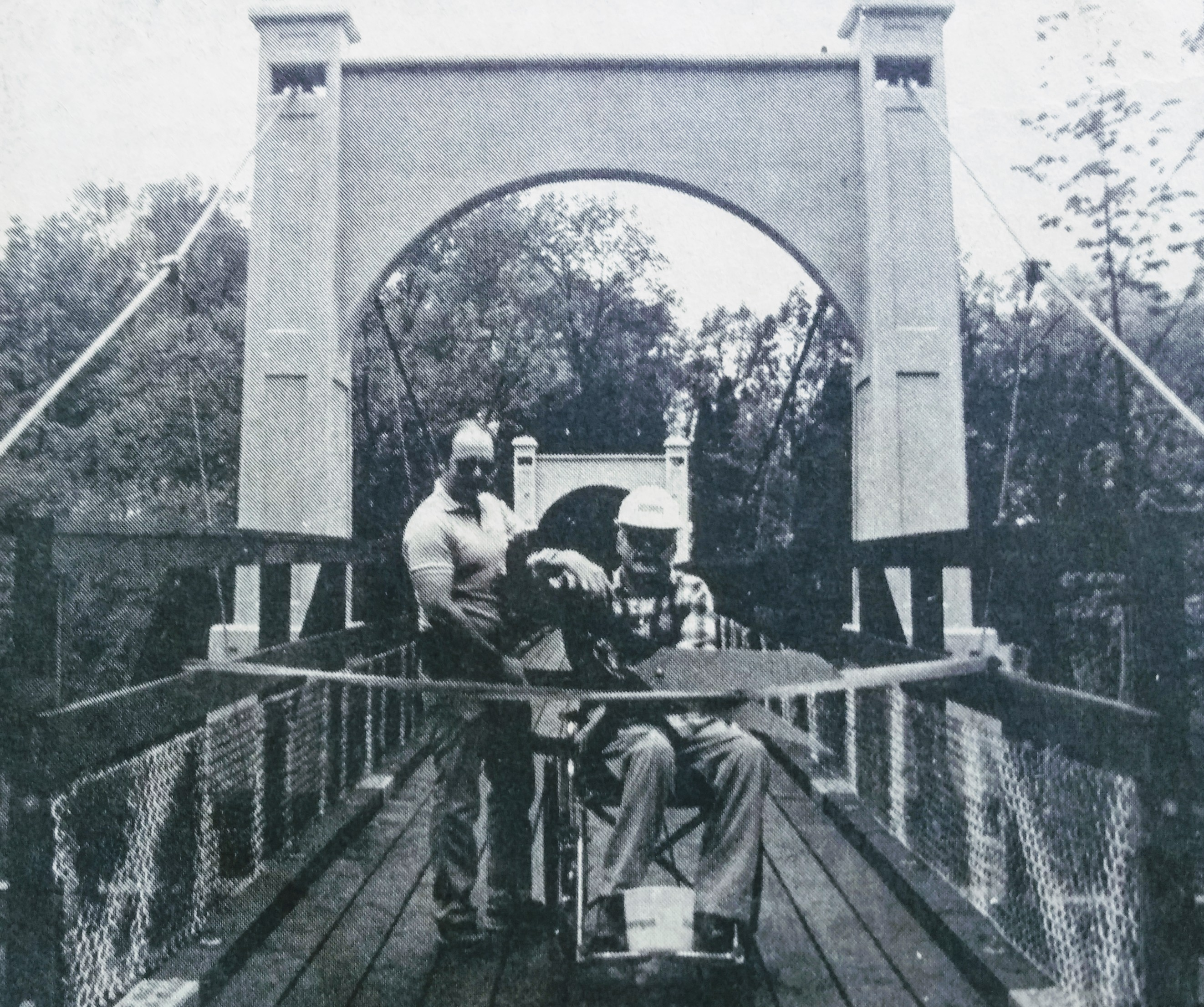 Pete Herpst (left) assists former city electrician Chuck Kelly with ribbon cutting, following the Swinging Bridge rehabilitation in 1986. (Photo by Pat Petricka, courtesy of RiverTown Multimedia and the River Falls Journal)